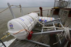 Inflatable liferaft in canister on board ship Stock Photography