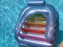 Inflatable lounger in pool Stock Images
