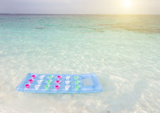 Inflatable mattress at beach Stock Photography