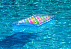 Inflatable mattress in pool royalty free stock image