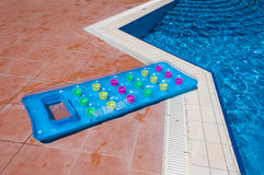 Inflatable mattress in  pool Stock Image