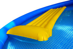 Inflatable mattress in pool Stock Images