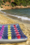 Inflatable mattress on the seashore Stock Photos