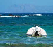 Inflatable motor boat on sea. Royalty Free Stock Photo
