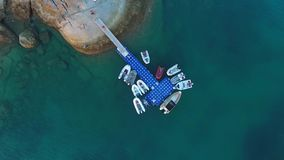 Inflatable motor boats parked at the pontoon pier. HD aerial shooting from above. Phuket, Thailand. stock footage
