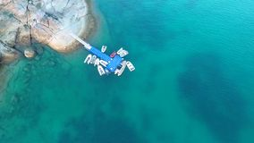 Inflatable motor boats parked at the pontoon pier. HD aerial shooting birds eye view. Phuket, Thailand. stock video