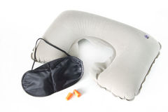 Inflatable neck pillow with eye mask and earplugs Stock Images