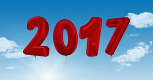 Inflatable 2017 numbers against a composite image 3D of clouds and sky. Inflatable 2017 numbers against a composite image 3D of clouds and blue sky Royalty Free Stock Photography