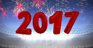 Inflatable 2017 numbers against a composite image 3D of fireworks Stock Images