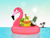 Inflatable pink flamingo with fresh fruit Royalty Free Stock Photo