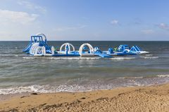 Inflatable playground in the sea at a specialized children`s bea. Ch of general use in the city of Evpatoria, Crimea, Russia stock image