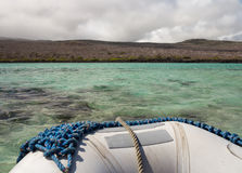Inflatable raft off coast of Galapagos Islands Royalty Free Stock Image