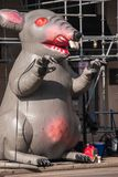 Inflatable rat is seen on the city street in front of a non-union construction site stock images