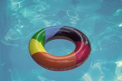 Inflatable ring float in pool blue water. Summer vacation and travel to ocean, Bahamas. Maldives or Miami beach. Relax. In spa luxury swimming pool. colorful stock images