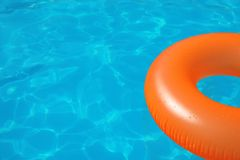 Inflatable ring floating in swimming pool on sunny day. Space for text royalty free stock image