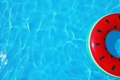 Inflatable ring floating in swimming pool on sunny day. Top view with space for text royalty free stock images