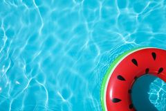 Inflatable ring floating in swimming pool on sunny day. Top view with space for text stock photos