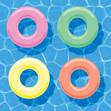 Inflatable Rings Floating On Water, Vector Stock Photo