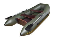 Inflatable rubber boat made of PVC, green, double, with oars. One inflatable rowing motor dinghy, dark green, rubber and PVC boat with two seats no body of Royalty Free Stock Photography