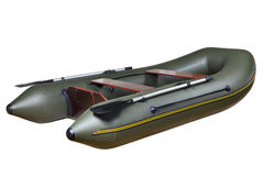 Inflatable rubber boat made of PVC, two-seat, twin, with oars. Dark green inflatable rubber boat for fishing and hunting, with two seats, two-person seat made Royalty Free Stock Photo