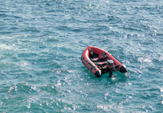 Inflatable rubber transport boat floating at sea Royalty Free Stock Photos