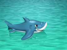 Inflatable shark floating on the sea surface Royalty Free Stock Photo