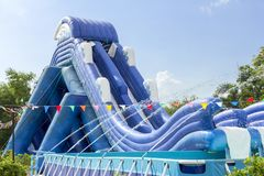 Inflatable slide bounce or water sliders at water park at bright day. stock images