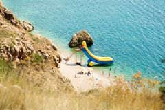 Inflatable slides. In the sea royalty free stock image