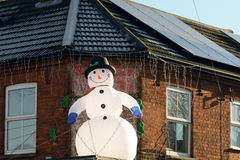 Inflatable snowman Christmas decoration. On roof of shop Royalty Free Stock Images