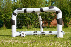 Inflatable soccer ball and goal Royalty Free Stock Photo