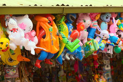 Inflatable Toys in Banos, Ecuador. BANOS, ECUADOR - FEBRUARY 22, 2014: Floaties, such as water wings, life vest and inflatable animals and figures hanging at a royalty free stock photo