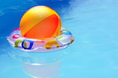 Inflatable toys in water. Inflatable ball and ring floating on the water in the pool Stock Image
