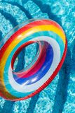 Inflatable water activities circles tuba float on the water in the pool. Concept, fun, perky summer and relaxation.  stock photos