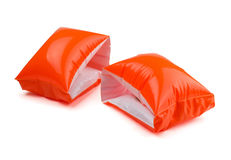 Inflatable water armbands. A pair of orange inflatable water armbands isolated on white royalty free stock photos