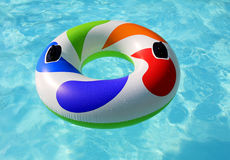 Inflatable wheel in pool Stock Photography
