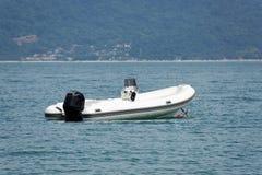 Inflatable white boat. The Inflatable white boat as beach theme royalty free stock photos