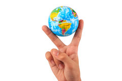 Inflatable world globe toy in hand making V sign. stock image