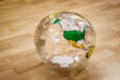 Inflatable world on wood floor Stock Images