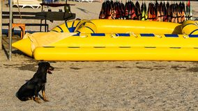Inflatable yellow boat, life vests royalty free stock image