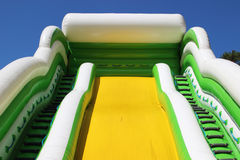 Inflatable yellow slide Royalty Free Stock Photo