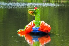 Inflated piece of art in pond. An inflated piece of art like a sort of duck in a pond Royalty Free Stock Image