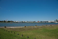 Inflatible oil boom stretches from Tauranga beach. Royalty Free Stock Photos