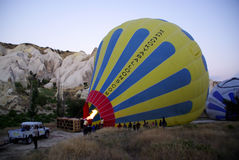 Inflating a balloon with hot air before taking off. Stock Images