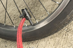 Inflating bicycle wheel Royalty Free Stock Photography