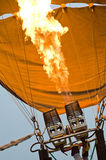 Inflating a hot air balloon. Inflating a hot air balloon with burners Royalty Free Stock Photography