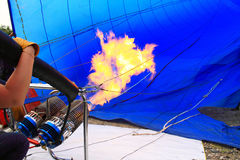 Inflating Hot Air Balloon. Worker To Inflating A Hot Air Balloon Royalty Free Stock Photo
