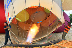 Inflating Hot Air Balloon. Worker To Inflating A Hot Air Balloon Stock Images