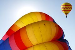 Inflating Hot Air Balloon Backlit by the Sun Stock Images