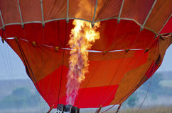 Inflating hot air balloon. Close to the flame from a propane burner inflating a red and orange hot air balloon Royalty Free Stock Photo