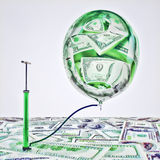 Inflating money. Royalty Free Stock Images